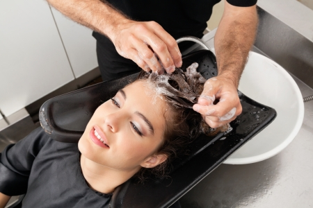 hairdresser parlor: Hairdressers Hand Washing Customer s Hair