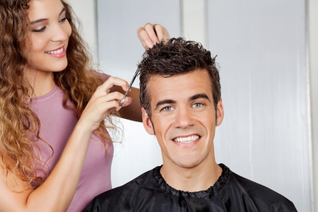 Client Getting Haircut From Hairdresser photo