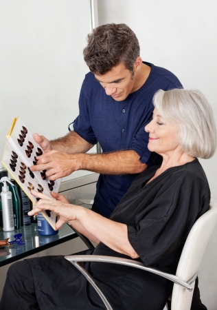 hair dye: Customer And Hairstylist Selecting Hair Color