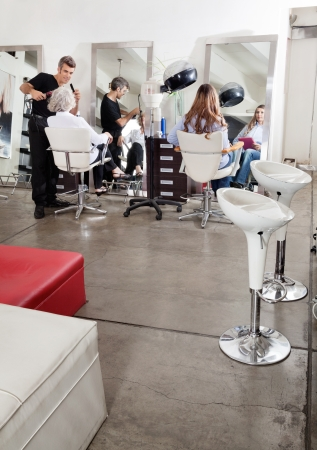 Customers And Hairstylist In Salon photo