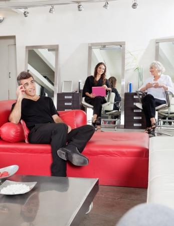 Customers Waiting At Hair Salon photo