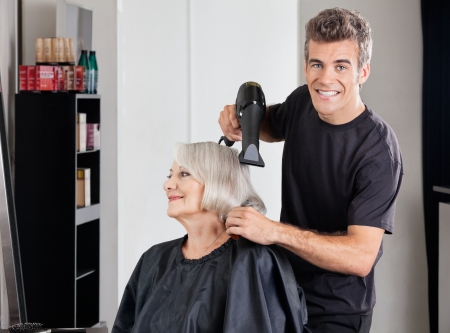 Male Hairdresser With Dryer Setting Customer s Hair Stock Photo - 18301836