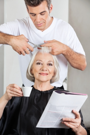 Customer Having Haircut At Parlor photo