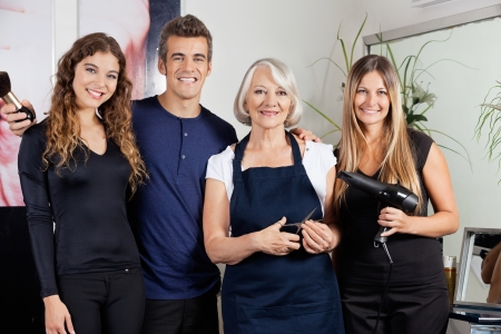 male hair: Confident Hairdressers Standing Together
