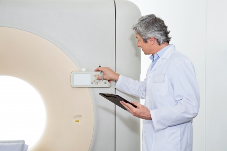 Doctor Operating CT Scan Machine photo