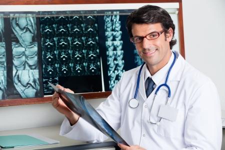 tomography: Happy Radiologist Holding X-ray