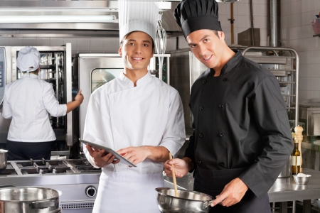 Happy Chefs Cooking Together photo