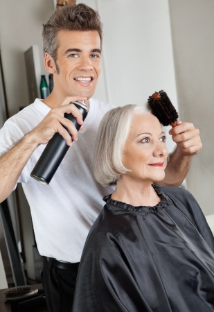 Hairdresser Setting Up Customer s Hair photo