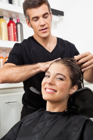 Female Client Having Her Hair Washed In Salon photo