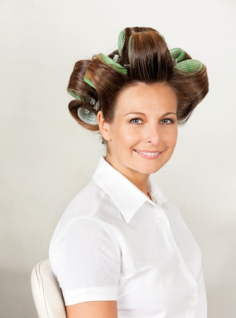 Client With Hair Curlers In Salon photo