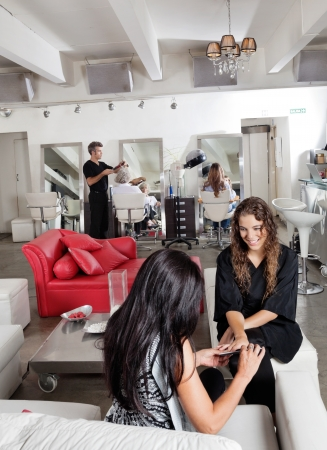 Woman Having Manicure At Parlor photo