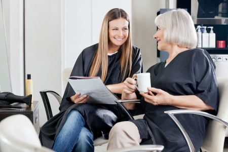 conversing: Female Client s Conversing At Beauty Parlor Stock Photo