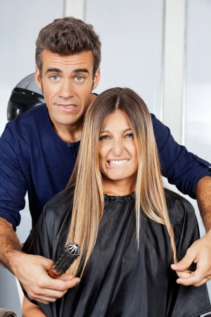 Hair Dresser And Client Making Faces photo