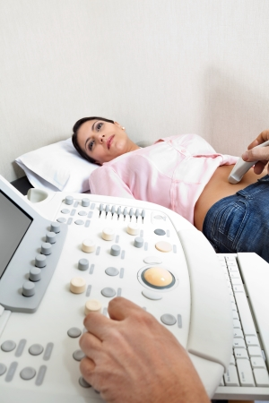 Female Going Through Abdomen Ultrasound photo