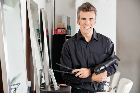 Male Hairstylist With Hairdryer And Straightener Stock Photo - 18393996