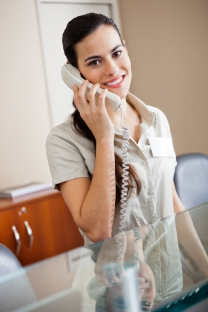 Female Receptionist Attending Call photo