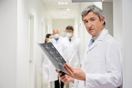lab tech: Radiologist Holding X-ray Stock Photo