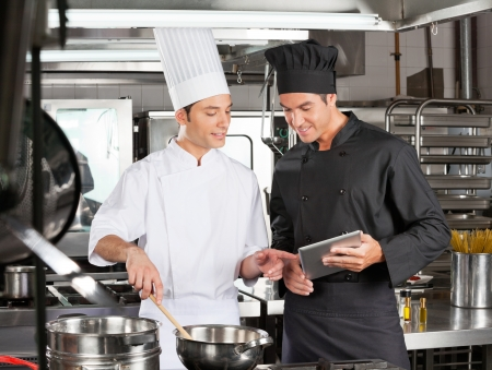 Male chefs Preparing Food Together Stock Photo - 18414496