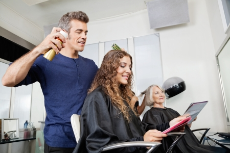 Hairdressers Setting Up Customer s Hair photo