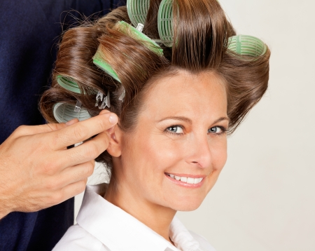 Client With Hairdresser Rolling Her Hair photo