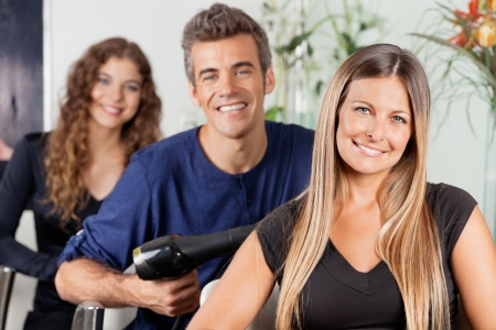 hairstylists: Happy Team Of Hairstylists At Salon