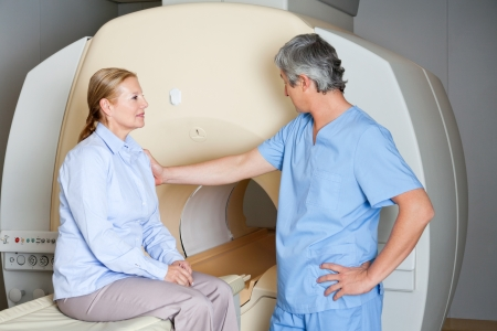 tomography: Technician Comforting Female Patient