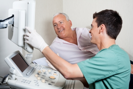sonography: Patient Looking At Ultrasound Machine