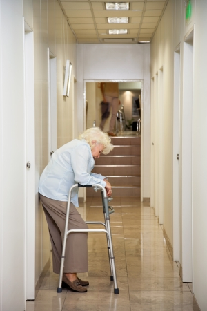 Elderly Woman Standing In Passageway photo