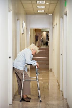 passageway: Elderly Woman Standing In Passageway Stock Photo