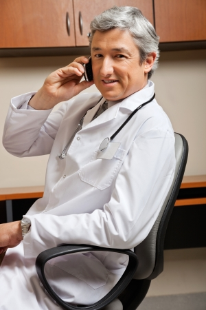 Doctor Answering Phone Call photo