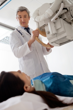 Radiologist Looking At Female Patient Stock Photo - 18521627