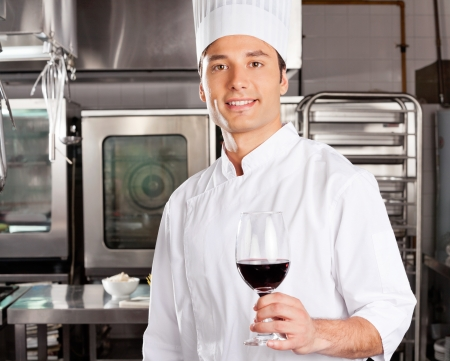 Young Chef Holding Wine Glass Stock Photo - 18521638