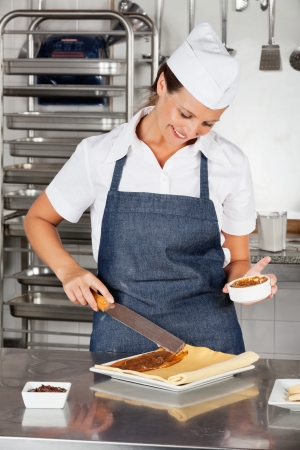 Female Chef Preparing Chocolate Roll photo