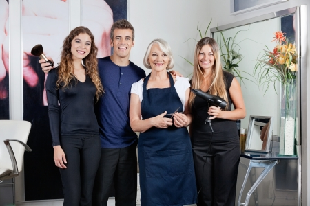 Team Of Hair Stylists In Salon photo
