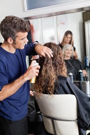 hair stylist: Hairstylists Setting Up Customer s Hair