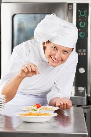 Happy Chef Adding Spices To Dish Stock Photo - 18793646