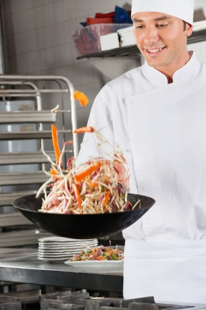 Chef Tossing Vegetables In Air Stock Photo - 18793398