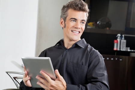 Male Client With Digital Tablet In Salon Stock Photo - 18793405