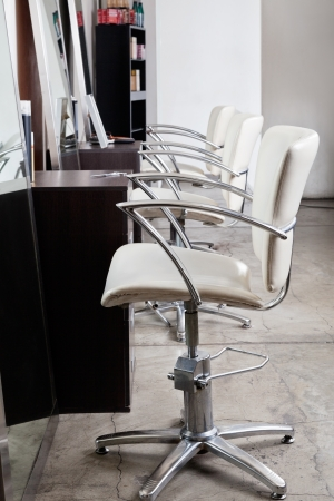beauty parlor: Chairs In Hair Salon Stock Photo