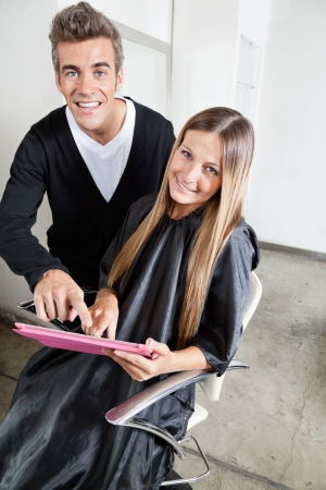 Hairstylist With Client Using Digital Tablet Stock Photo - 18793416