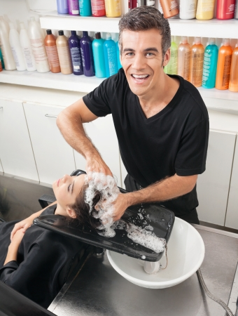 Hairstylist Washing Customer s Hair Stock Photo - 18793647