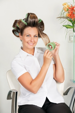Female Client Removing Curlers