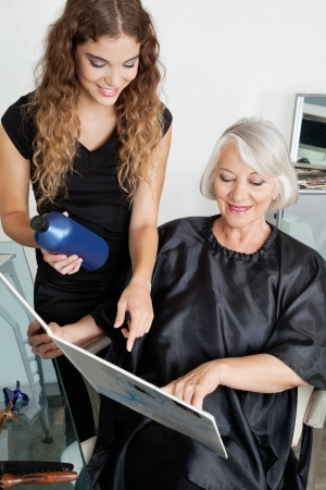 Client And Hairdresser Choosing Hair Color photo