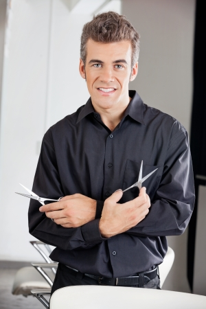Confident Hairstylist Holding Two Scissors Stock Photo - 18793404