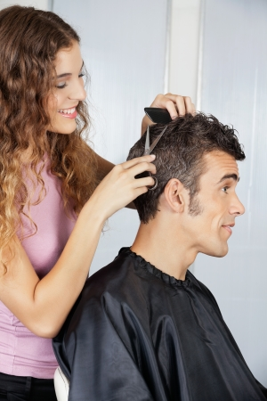 Female Hairdresser Cutting Client s Hair photo