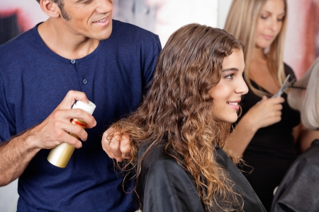 Hairdresser Fixing Woman s Hair With Spray Stock Photo - 18793420