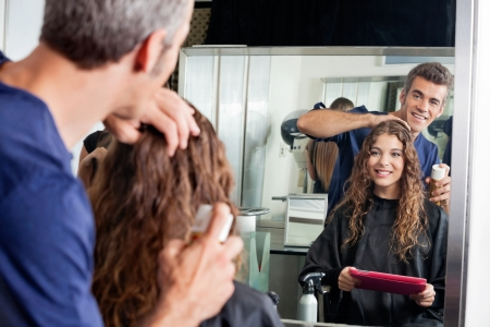 Hairdresser Setting Client s Hair While Looking At Mirror Stock Photo - 18793650
