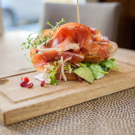 Parma Ham Sandwich On Wooden Plate photo