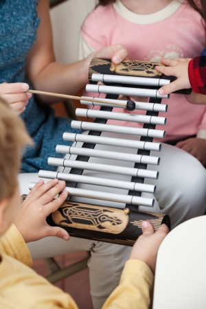 xylophone: Teacher And Students Playing Xylophone In Class Stock Photo