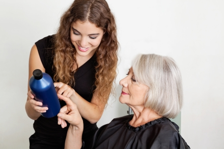 advising: Hairdresser Advising Hair Color To Client